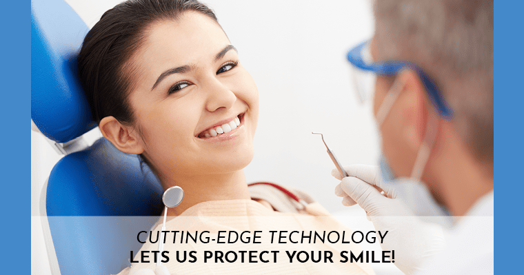 Smiling patient in dental chair being examined by dentist.
